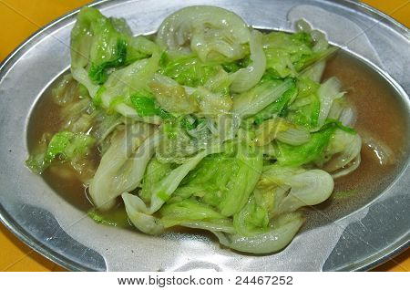 sauce cooked green vegetable on the plate