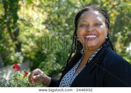 Happy Mature Woman In Her Garden