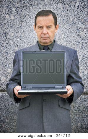 Fabricante de dinheiro com Laptop