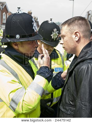 Devon And Cornwall Policeman speaks forcefully to a Plymouth Argyle supporter