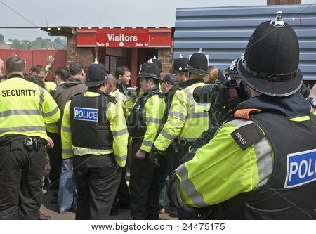 Devon And Cornwall Police Photograph Plymouth Argyle Supporters As They Enter The League 1 Match