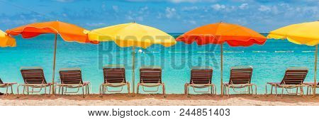 Beach chairs and umbrellas vacation