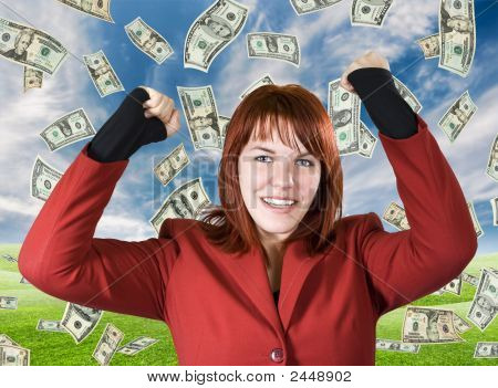 Girl Rejoicing A Win With Dollars Falling From The Sky