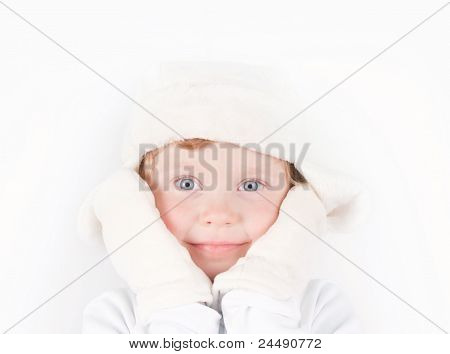 Little Girl In Winter Hat With Ear Flaps