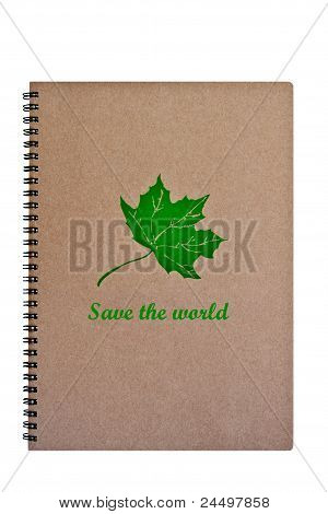 Save The World Word On Brown Notebook With Green Leaf, Isolated On White Background