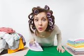 Close Up Fun Young Housewife With Curlers On Hair In Light Clothes Ironing Clothing On Ironing Board poster