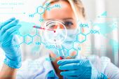 Young Attractive Female Scientist Researching In The Laboratory With Futuristic Scientific Air Inter poster