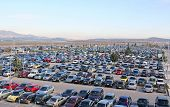 stock photo of parking lot  - A parking lot with a lot of cars parked in - JPG