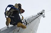 stock photo of ascending  - Tower climber ascending 100 feet cell tower - JPG