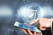 Side View Of Businessman Hand Pointing At Smartphone With Antivirus Interface. Cyberspace Safety Con poster