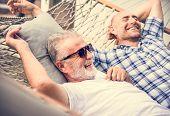 Senior men chilling on a hammock poster