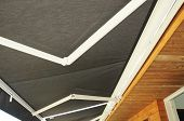 Protection Against Sun And Heat. Sun Protection Patio Awning . Outdoor Patio Sun Shade Awning.  Wood poster