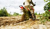 Motocross Racer Racing On The Off-road Circuit Mud Flying Through Air. Motorbike Rides Through The M poster