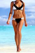 Bikini body sexy woman on beach wellness spa skincare. Tanned smooth legs and weight loss toned stom poster
