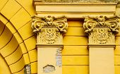 European Building Exterior, Old Columns With Cracks. Historical House Exterior Decor In Baroque Styl poster