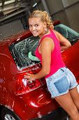 picture of car wash  - Sexy woman washing her car in the garage - JPG
