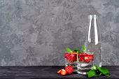 Lemonade Drink Of Soda Water, Strawberry And Mint Leaves In Glass With Bottle Of Water On Wooden Tab poster