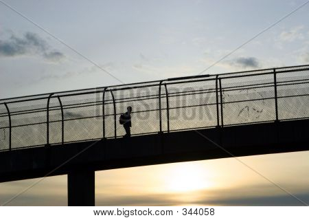 Boy Crossing Bridge