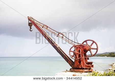 Old Red Rusty Crane On Shore