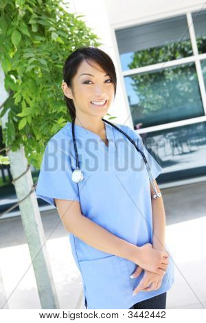 Pretty Asian Nurse At Hospital