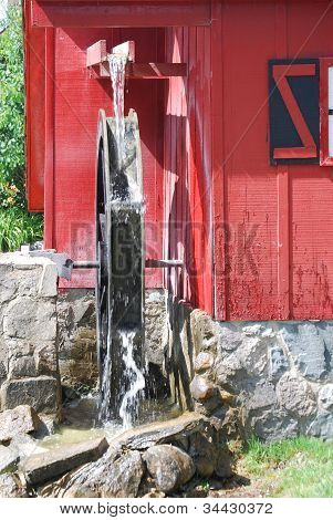 A Water Wheel on a Red Grist Mill