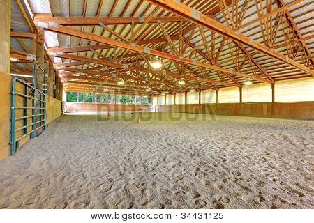 Large Horse Arena Riding Area With Sand Interior.