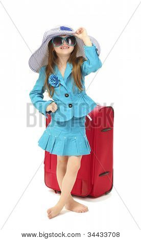 Portrait of little girl with travel case, sunglasses and hat isolated on white