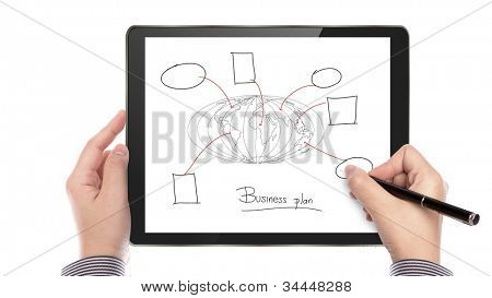 Business man write business plan on touch screen device