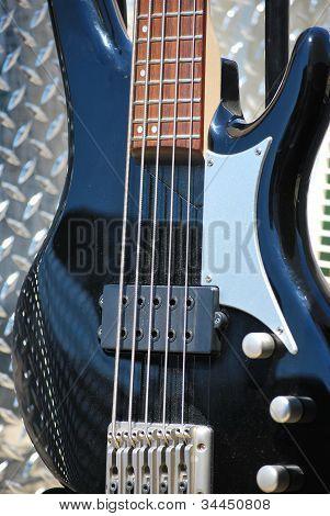 Electric bass guitar.