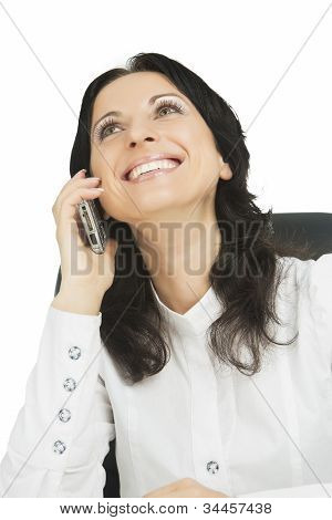 Lovely Businesswoman Wearing White Sitting And  Takling On Mobile