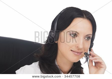 Portrait Of Brunette Call-center Customer's Support Operator With Headset Talking
