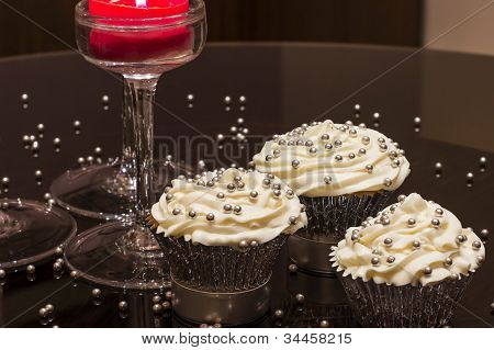 White Cupcakes on a Reflective Table