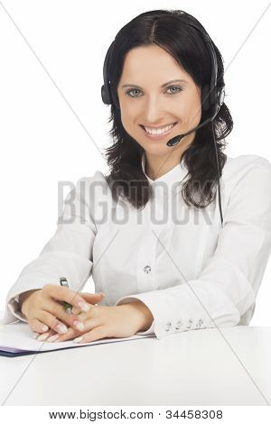 Portrait Of Young Smiling Brunette Call-center Customer's Support Operator With Headset Sitting Isol