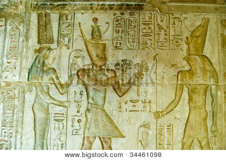 Pharaoh Ptolemy IV with Maat and Horus