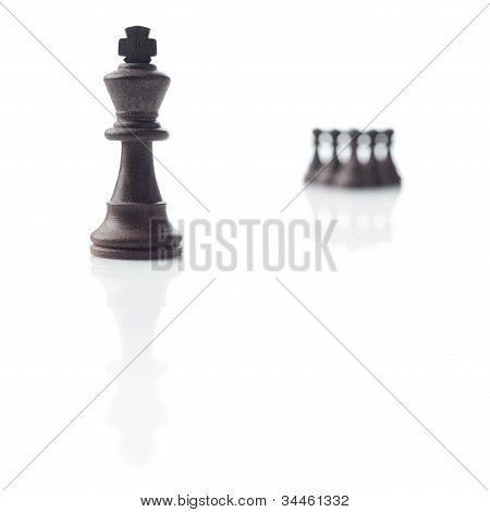 Chess. Black King, Pawns And Their Shadows On White Background