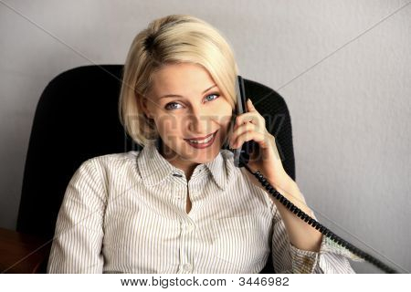 Young Businesswoman Talk On The Phone In The Office