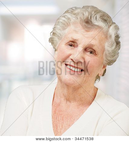 portrait of a senior woman smiling against an abstract background