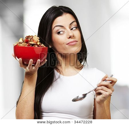 woman holding a delicious red breaksfast bowl, indoor