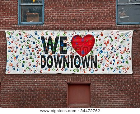 We Love Downtown Sign On Brick Wall
