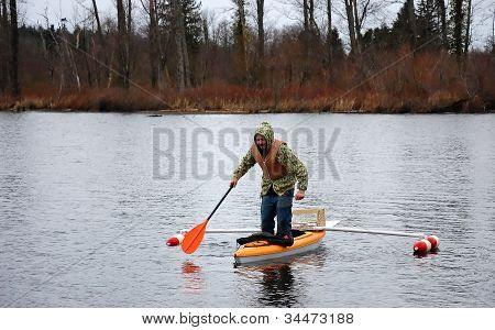 Man Standing In Canoe