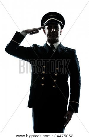 one caucasian man in airline pilot uniform saluting silhouette  in studio isolated on white background