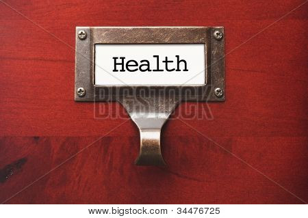 Lustrous Wooden Cabinet with Health File Label in Dramatic Light.
