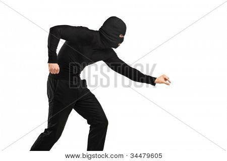 A man in robbery mask trying to steal something isolated on white background