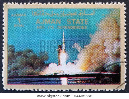 Postage stamp Ajman 1973 Saturn V Rocket Launching