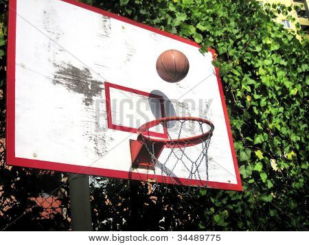 an image of playing basketball at the outside