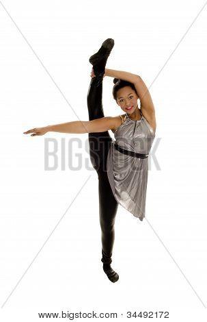Very Flexible African American Jazz Dancer In Leg Extension