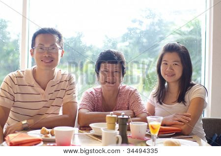 Happy Asian family dining at restaurant