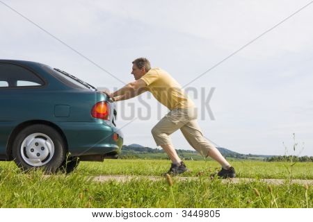 Man Pushing His Car