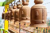 Brass Bells Hanging On Steel Bar At Buddhism Temple. Copper Bells.thai Bells. poster
