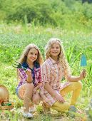 Sisters Cute Kids Helping At Farm. Girls Planting Plants. Planting And Watering. Cheerful Children W poster